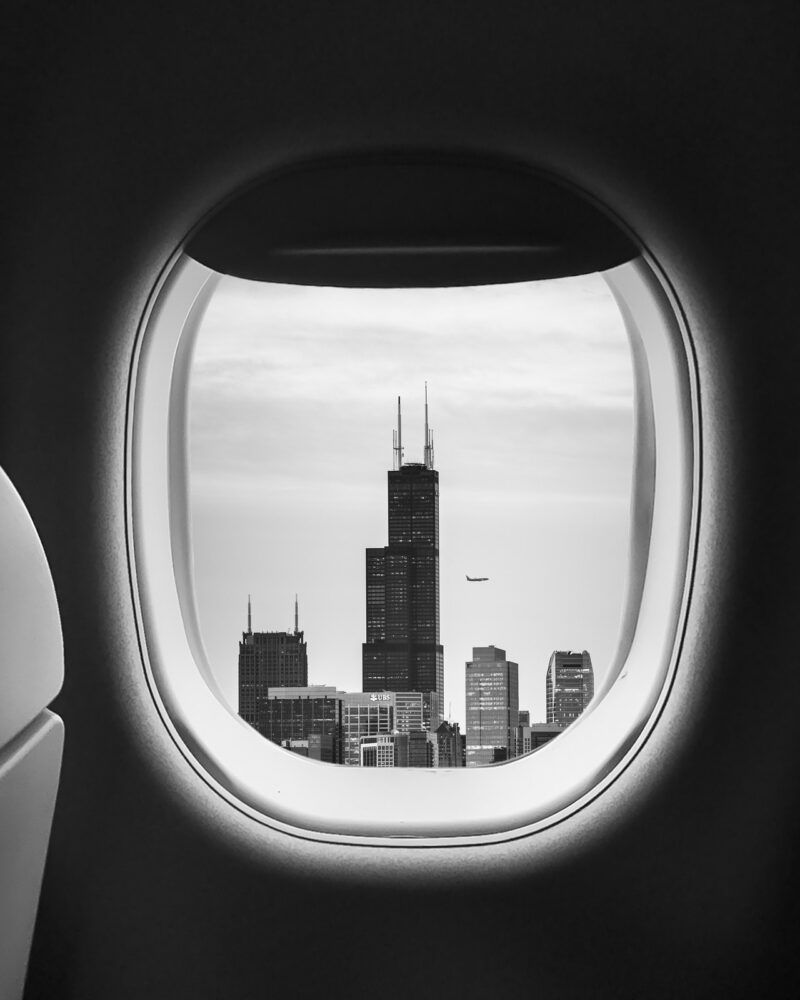 airplane window with city outside